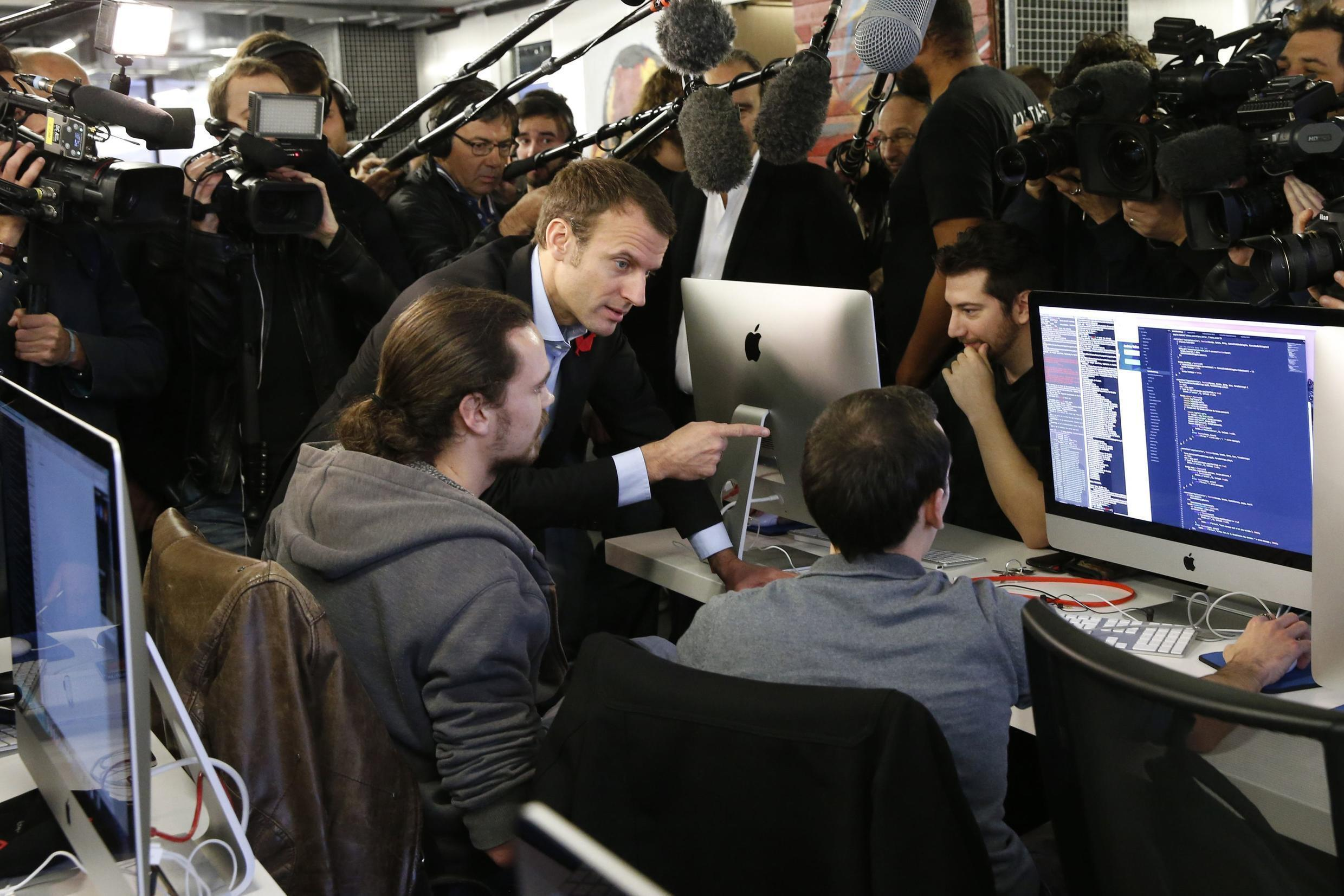 Emmanuel Macron, here when he was Economy minister, with students during a visit to the Ecole 42 free computer programming school Paris in October 2015.