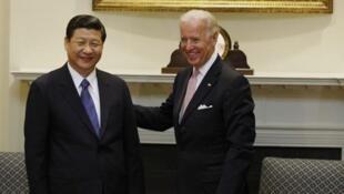 2012年2月,时任副总统拜登在华盛顿会晤将在几个月后升任中国总书记的习近平。