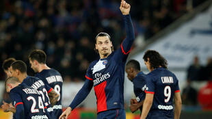 Paris St Germain's Zlatan Ibrahimovic (C) celebrates with his team mates after scoring against FC Nantes during their French Ligue 1 soccer match at the Parc des Princes Stadium in Paris January 19, 2014.