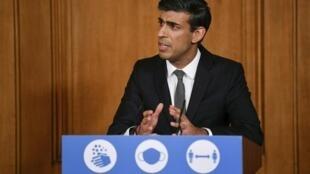 Le chancelier de l'Échiquier britannique Rishi Sunak, lors d'un point sur l'évolution du Covid-19, à Londres le 12 octobre 2020.