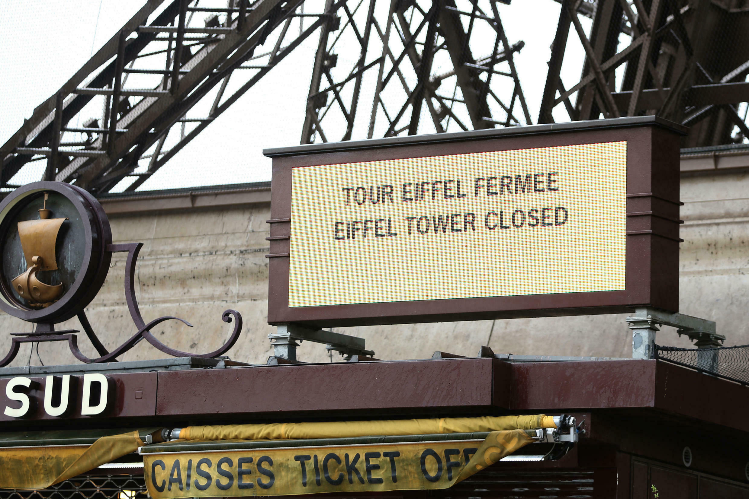 A sign announcing the closure of the Eiffel Tower is seen at a closed ticket sales counter in Paris, France, March 31, 2016 as part of labor reform protests