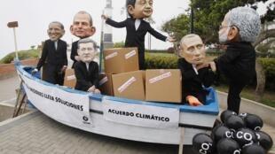 Les présidents des pays grands pollueurs et mauvais payeurs épinglés par les ONG de défense de l'environnement qui manifestaient en marge de la COP20 à Lima, le 14 décembre.