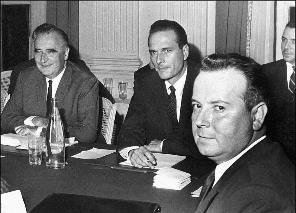 French prime minister and future president Georges Pompidou (L) with Jacques Chirac (C) and Georges Seguy, chairman of the pro-communist CGT trade union, 27 May 1968.