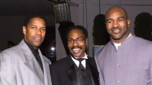 """Da esquerda para a direita: Denzel Washington, Rubin """"Hurricane"""" Carter e Evander Holyfield."""