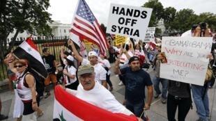 Des opposants à une intervention en Syrie, devant la Maison Blanche, le 9 septembre 2013.
