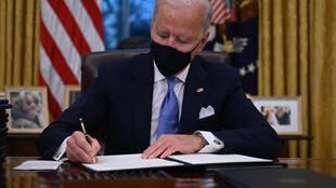 President Joe Biden signing executive orders soon after his inauguration on Wednesday