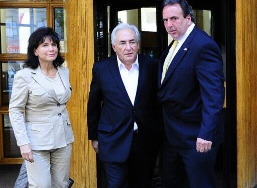 Dominique Strauss-Kahn, accompanied by his wife,  Anne Sinclair, leave his lawyer's office