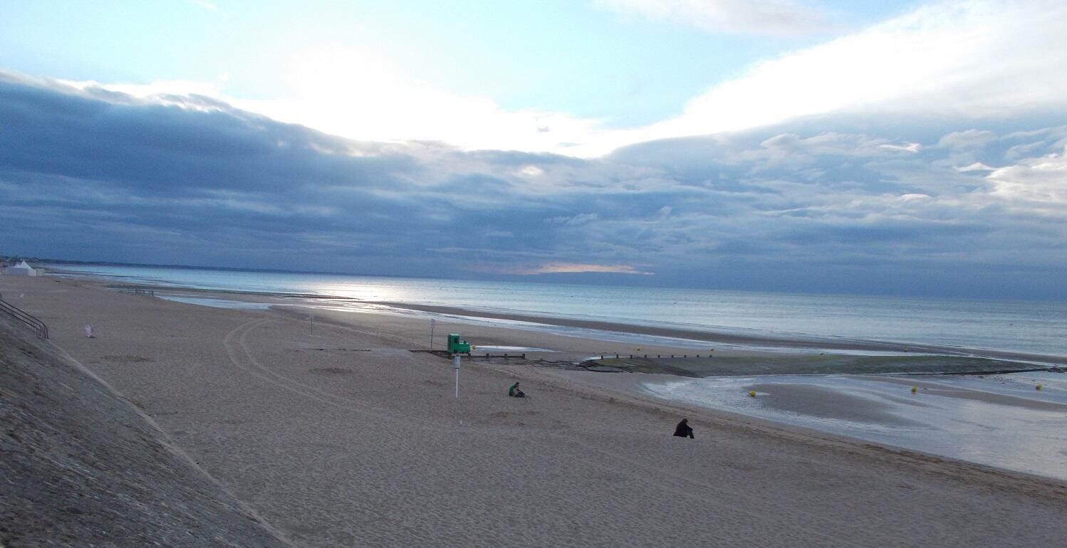 Cabourg Beach with typical and natural romantically lit horizon