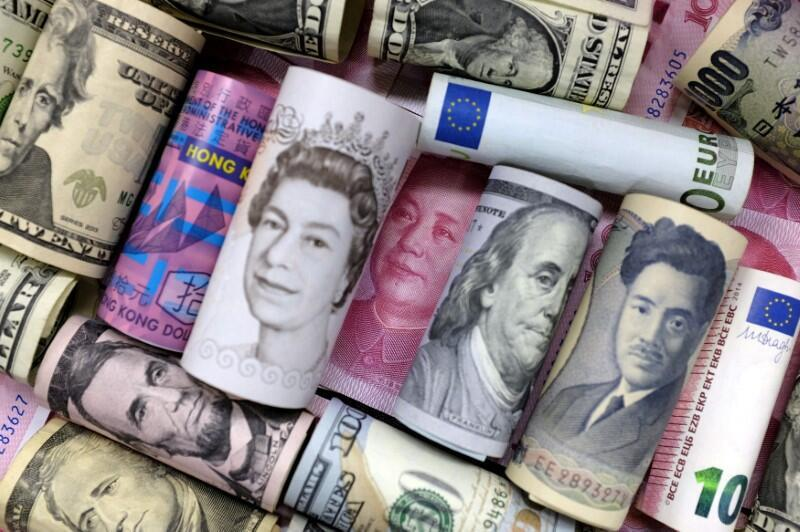 Euro, Hong Kong dollar, U.S. dollar, Japanese yen, pound and Chinese 100 yuan banknotes are seen in this picture illustration, J