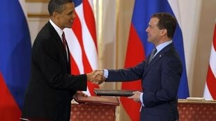 Barack Obama and Dmitry Medvedev shake hands after signing the new Start treaty in Prague Castle, 8 April 2010