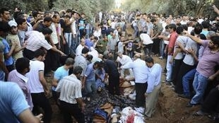 Mass burial of opposition activists killed by Bashar al-Assad forces, in Jdeidet Artouz near Damascus, 1 August 2012