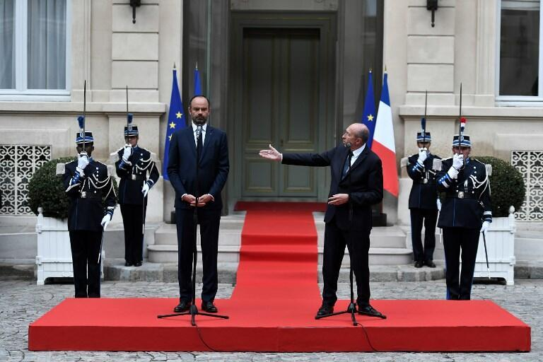 Gerard Collomb hands over his Interior Ministry duties to Prime Minister Edouard Philippe, as search for replacement will take days