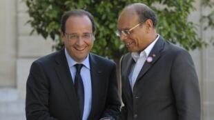 François Hollande et Moncef Marzouki lors de leur dernière rencontre, au palais de l'Elysée à Paris, le 17 juillet 2012.