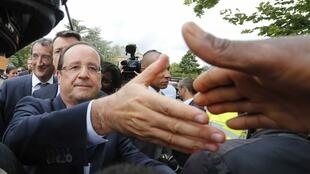 François Hollande during a visit to Clichy-sous-Bois on Wednesday.