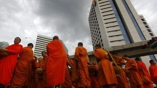 Buddhist monks pray for peace in downtown Bangkok.