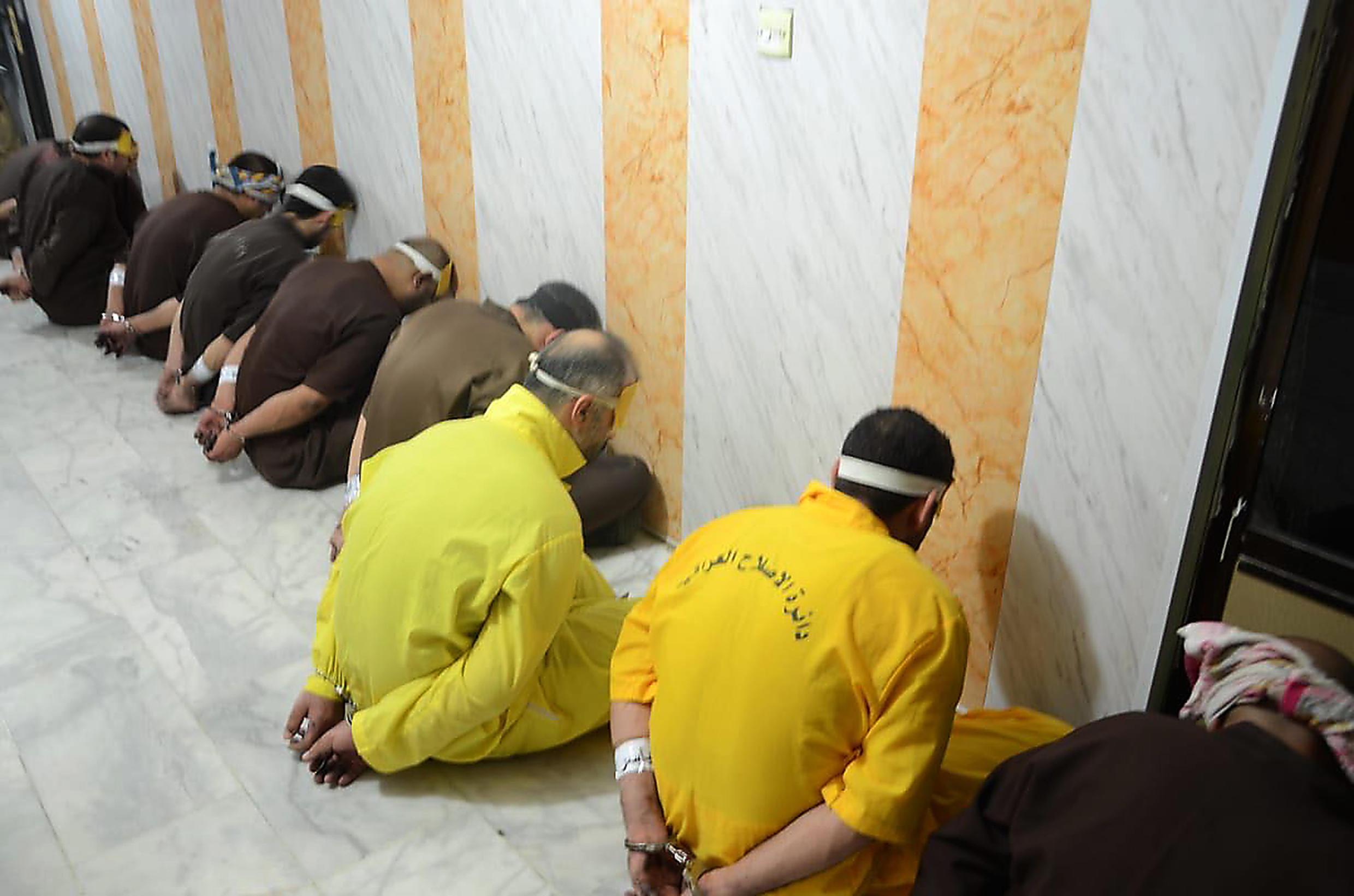 """Iraq on Monday hanged three people for """"terrorism"""": this 2018 photograph released by the Iraqi Justice Ministry shows Islamic State group members condemned to death"""