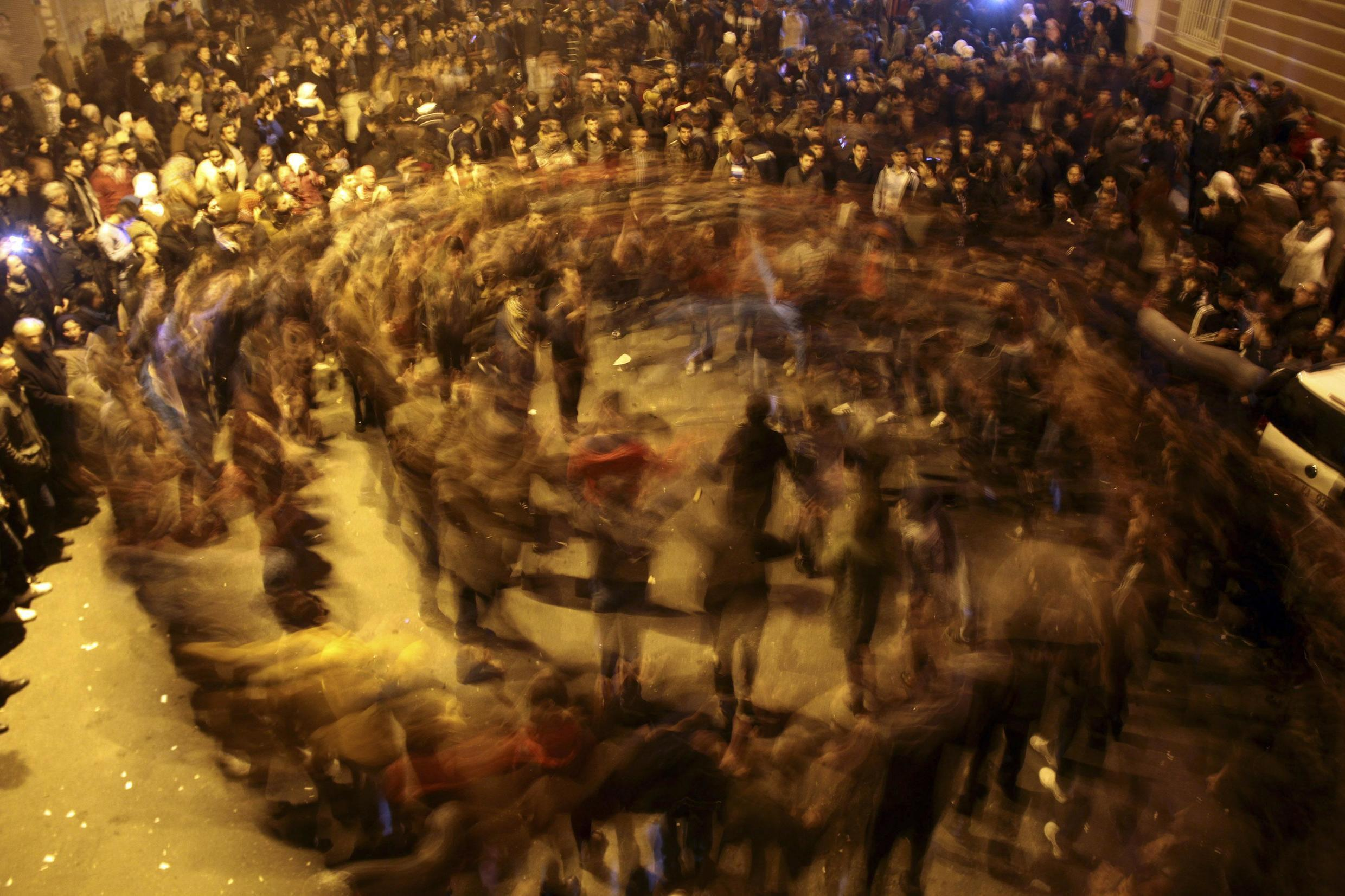 People dance as they celebrate in Diyarbakir after Kurdish forces took full control of the Syrian town of Kobane