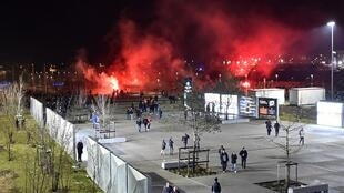 Lyon's fans use red flares before the Europa League football match Olympique Lyonnais vs CSKA Moscow on 15 March, 2018 in Decines-Charpieu.