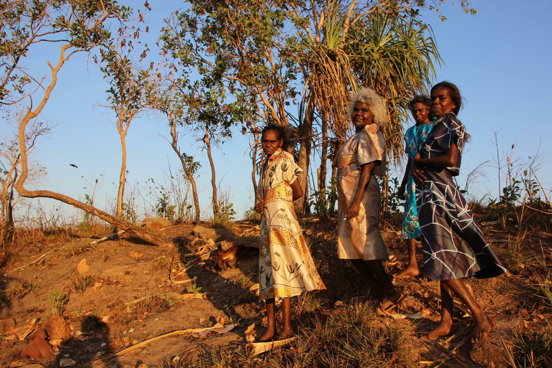 Babbarra Women's Centre artists wearing their designs in the Maningrida landscape, Australia
