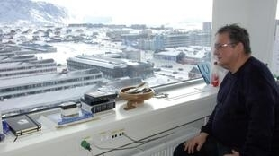 Greenland's Prime Minister Kuupik Kleist looks out from his office in Nuuk, 7 March, 2013