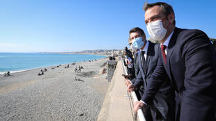 French Health Minister Olivier Véran (R) and Nice mayor Christian Estrosi (2ndR) look out across the Mediterranean after a visit to the CHU Hospital in Nice, southern France, February 20, 2021.