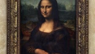 """The """"Mona Lisa"""" will remain protected by bulletproof glass in its temporary home."""