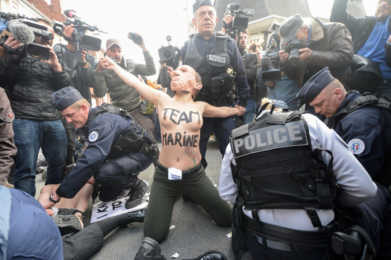 Femen members demosntrate against National Front leader Marine Le Pen