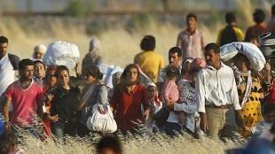 Les Kurdes syriens ayant fui le guerre dans leur pays, sont inquiets pour leur famille restée sur place. (Photo d'archives: des réfugiés kurdes syriens en Turquie)