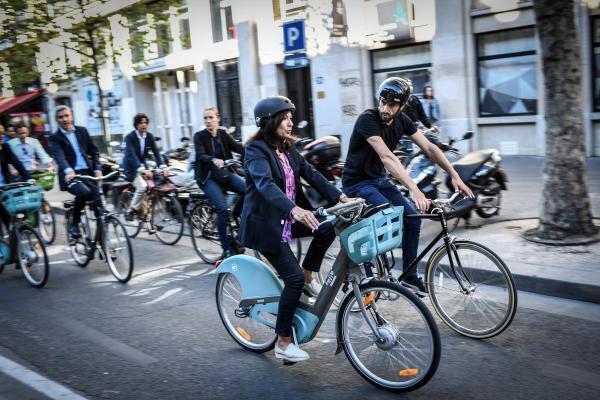 Anne Hidalgo bikes around Paris on the city's rental bike service Velib, September 2019.