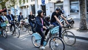 Anne Hidalgo bikes around Paris on the city's rental bike service Velib, September 2019.