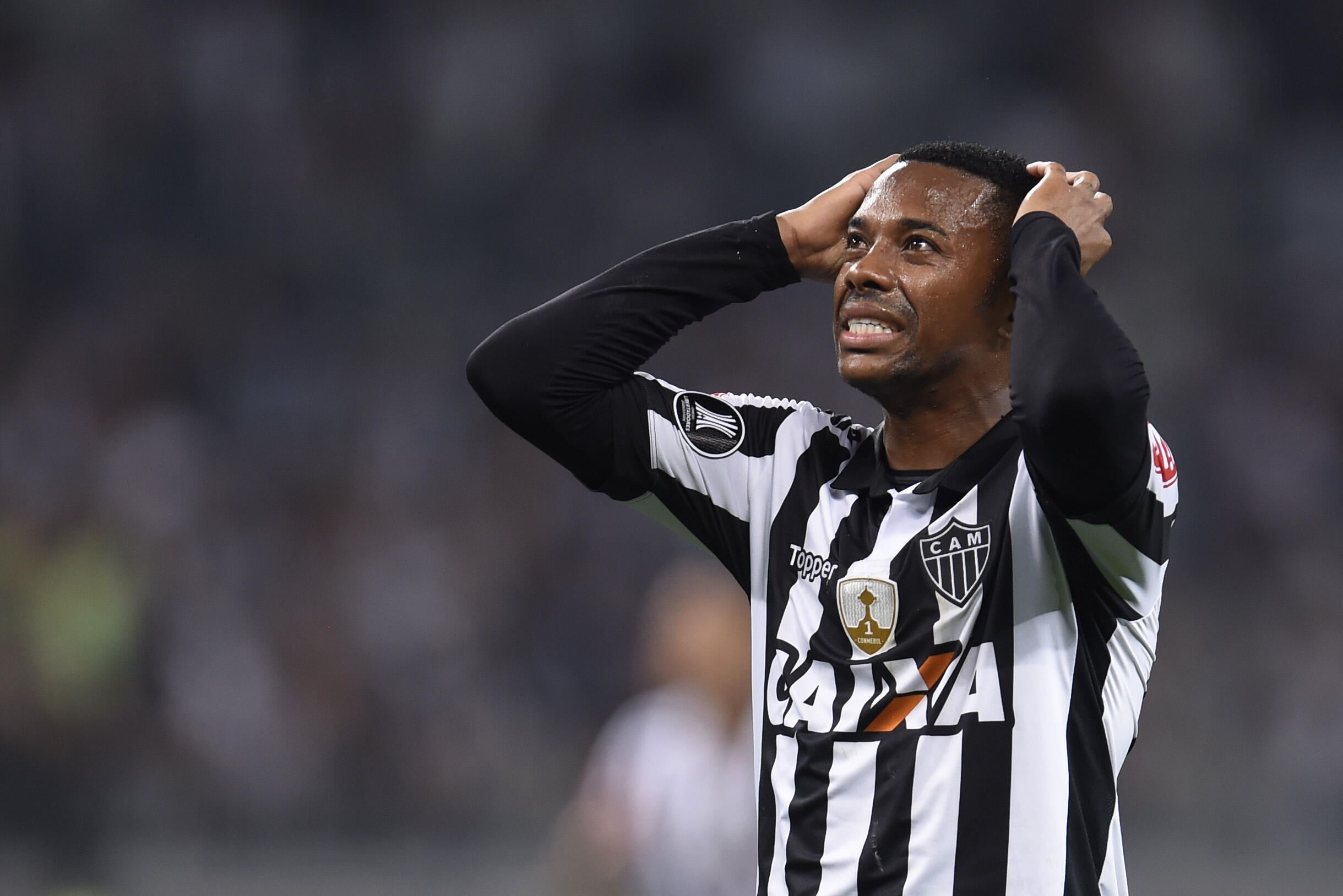 Brazilian footballer Robinho has been forced to part ways with his former club Santos amid pressure over his conviction for gang rape by an Italian court, a charge he denies