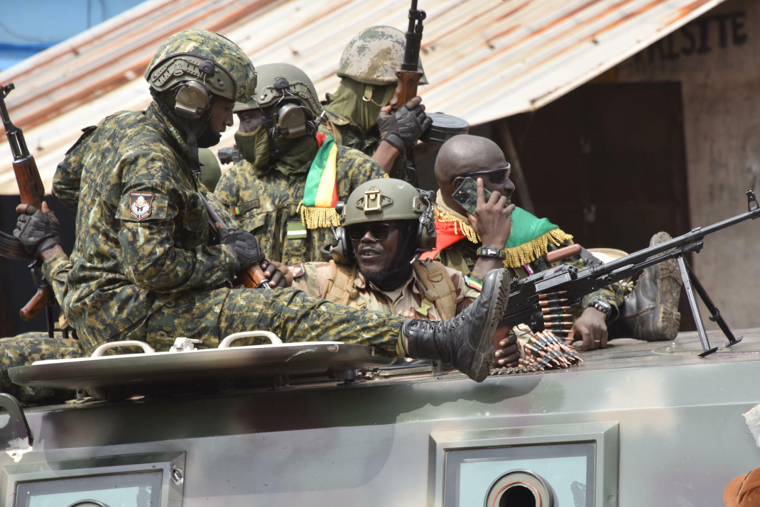 Guinean troops celebrate after President Alpha Conde is overthrown