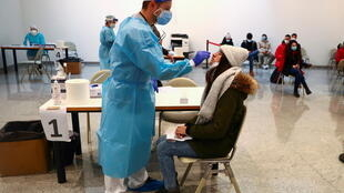 2021-01-20T113740Z_1699986001_RC2NBL9J6YN6_RTRMADP_3_HEALTH-CORONAVIRUS-SPAIN-TESTS