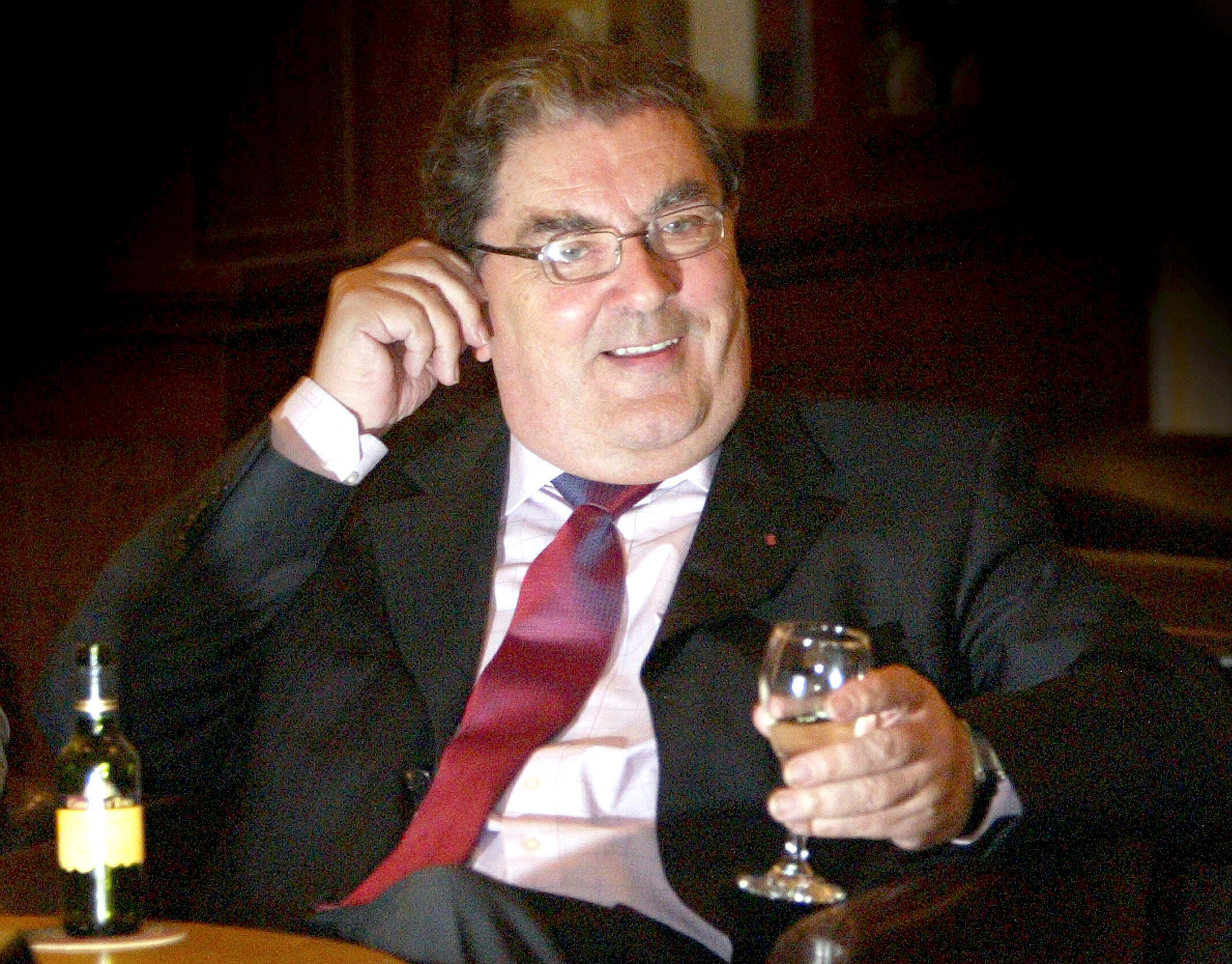 Former Social Democratic and Labour Party (SDLP) leader and MP for Foyle, John Hume, sits with a drink after announcing at a news conference in Belfast, that he will not be standing again for the European Parliament, February 4, 2004.