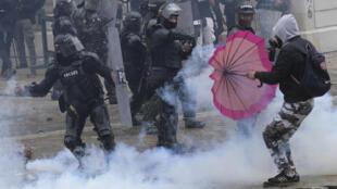 Demonstrators clash with police in Bogota, on April 28, 2021