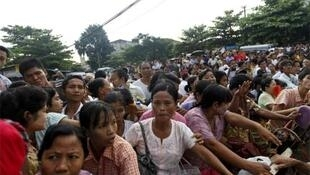 Relations of prisoners wait outside Insein Prison gate in Yangon on Wednesday