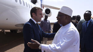 Mali's President Ibrahim Boubacar Keita (R) greets French President Emmanuel Macron upon his arrival to visit the troops of France's Barkhane counter-terrorism operation in Africa's Sahel region in Gao, northern Mali, on May 19, 2017.