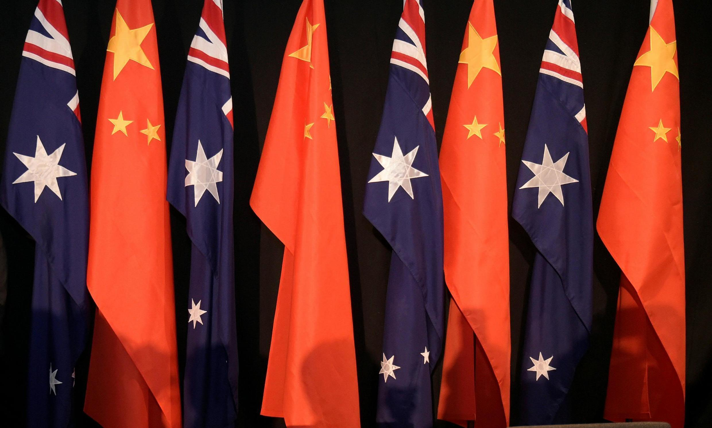 This file photo taken on June 17, 2015 shows national flags of China and Australia during a signing ceremony in Canberra. China on May 6, 2021 suspended an economic agreement with Australia, worsening an already-troubled relationship fractured by spats over the Covid-19 pandemic and human rights abuses.