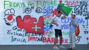 Graffiti painted by anti-G7 activists in Hendaye, south west France, 22 August 2019.