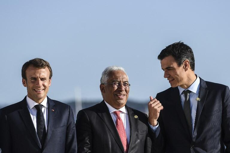 (L-R) French President Emmanuel Macron, Portuguese Prime Minister Antonio Costa and Spanish Prime Minister Pedro Sanchez at the Energy Interconnections Summit in Lisbon on July 27, 2018.