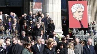 Après les obsèques d'Alain Resnais à l'église Saint-Vincent-de-Paul à Paris, lundi 10 mars 2014.