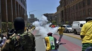 ANC supporters flee after they tried to confront members of the opposition Democratic Alliance party in Johannesburg