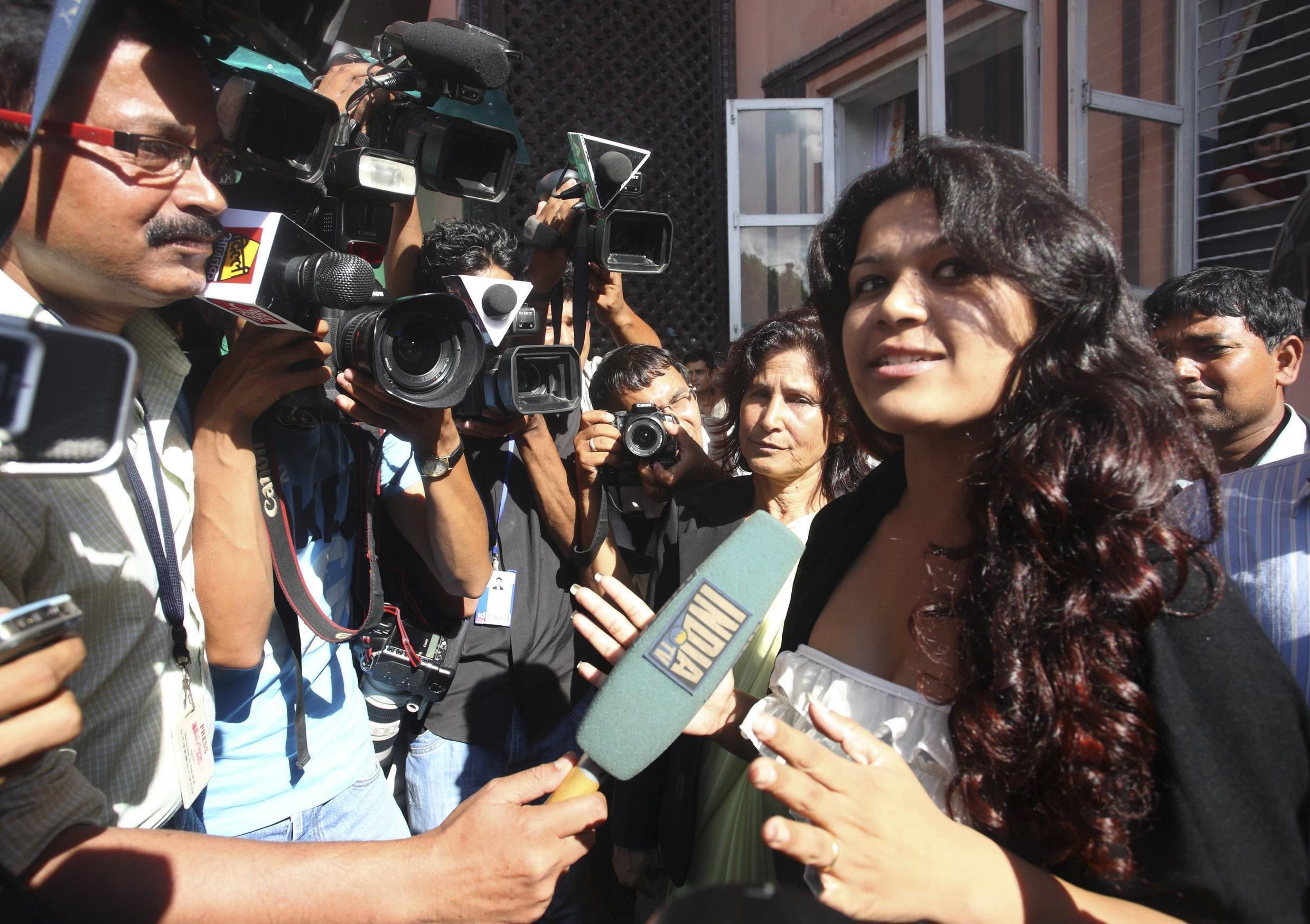 Biswas, fiancee of 65 year-old serial killer Sobhraj of France, speaks to the media at the Supreme Court in Kathmandu