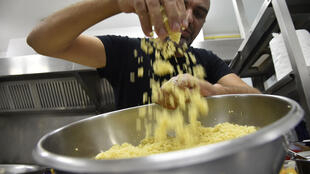 Algerian chef Rabah Ourrad prepares a dish of couscous at a kitchen in the capital Algiers