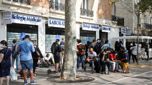 People wait in line at a Covid-19 testing site in Paris.