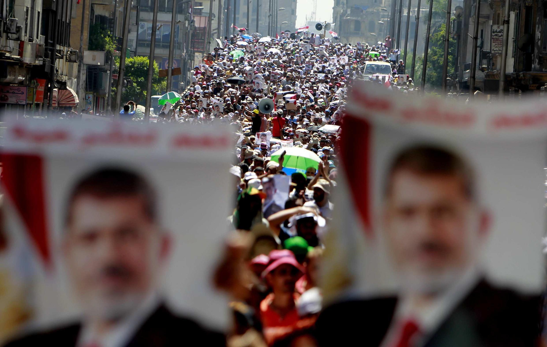 Des partisans du président Morsi, le 30 juillet au Caire.