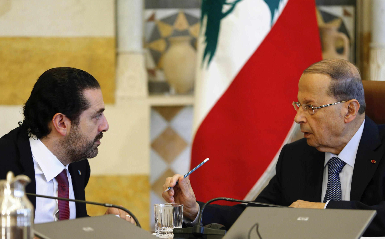 Lebanon's President Michel Aoun talks to Prime Minister Saad al-Hariri during Tuesday's cabinet meeting