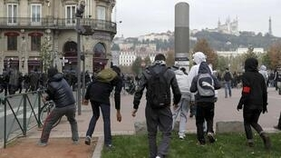 Youths clash with police after a demonstration in Lyon on 19 October