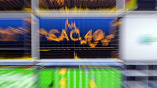 A screen shows the Cac-40 index in Euronext's market services surveillance room in Courbevoie