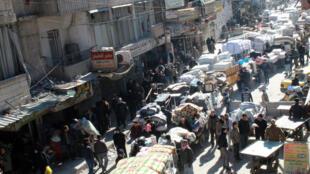 População de Aleppo em fuga, Síria.